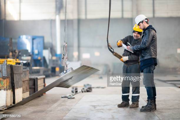 job interview within the factory - hoisting stock pictures, royalty-free photos & images