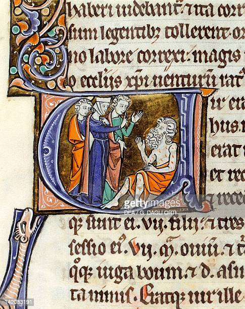 Job receiving a visit from wife miniature from Latin Bible from the abbey of Mount Saint Eligius Latin manuscript folio 112 verso France 12th13th...