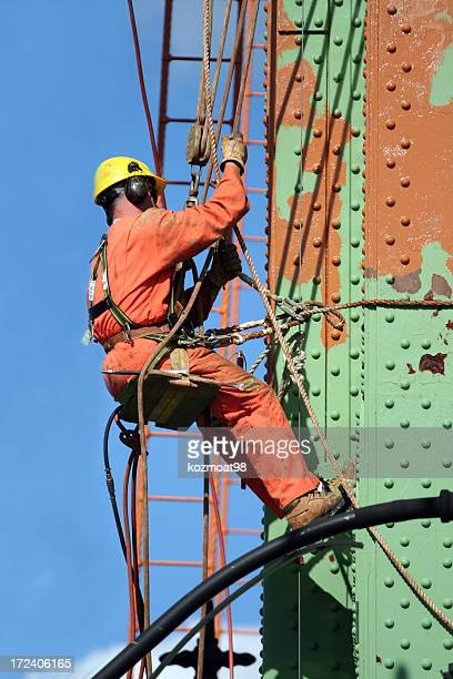 job security - safety harness stock photos and pictures