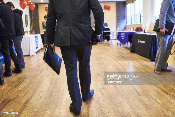 A job seeker arrives for a Shades of Commerce Career Fair in the Brooklyn borough of New York US on Saturday Feb 17 2018 The latest initial jobless...