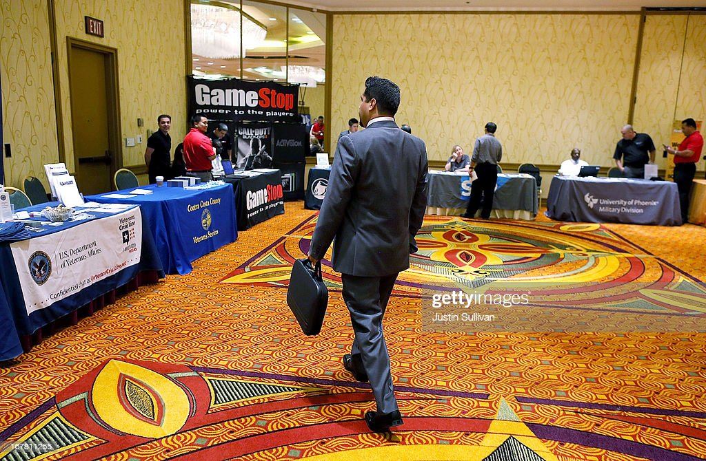 A job seeker carries a briefcase as he walks around the 'Hiring Our Heroes' job fair on April 30, 2013 in Walnut Creek, California. Seventy-five active duty members of the military and veterans registered to attend the 'Hiring Our Heroes' job fair hosted by the U.S. Department of Commerce. Hundreds of 'Hiring Our Heroes' events are being held across the country in 2013 in the hopes of having a half million military veterans employed by the end of 2014.