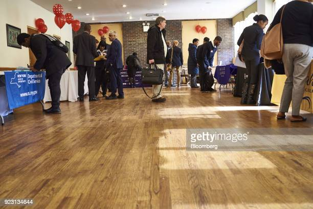 A job seeker center arrives for a Shades of Commerce Career Fair in the Brooklyn borough of New York US on Saturday Feb 17 2018 The latest initial...