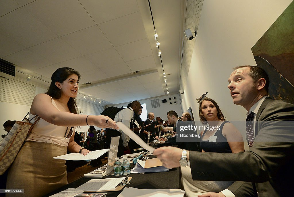Job seeker Desiree Passaro, left, leaves her resume with a recruiter during the NYC Restaurant Job Expo at the Gabarron Foundation in New York, U.S., on Tuesday, April 9, 2013. The U.S. Department of Labor is scheduled to release jobless claims figures on April 11. Photographer: Peter Foley/Bloomberg via Getty Images