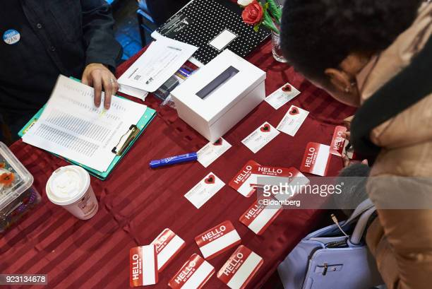 A job seeker fills out a name tag during a Shades of Commerce Career Fair in the Brooklyn borough of New York US on Saturday Feb 17 2018 The latest...