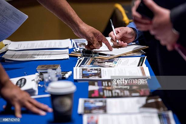 A job seeker fills out an employment application at the San Jose Career Fair in San Jose California US on Tuesday Nov 10 2015 The US Department of...