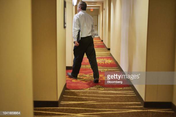 A job seeker leaves a National Career Fair event in Edison New Jersey US on Thursday Sept 20 2018 Filings for US unemployment benefits rose last week...