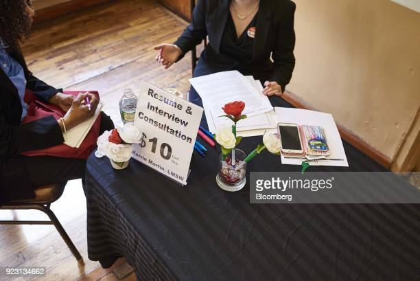 A job seeker left listens during resume consultation during a Shades of Commerce Career Fair in the Brooklyn borough of New York US on Saturday Feb...