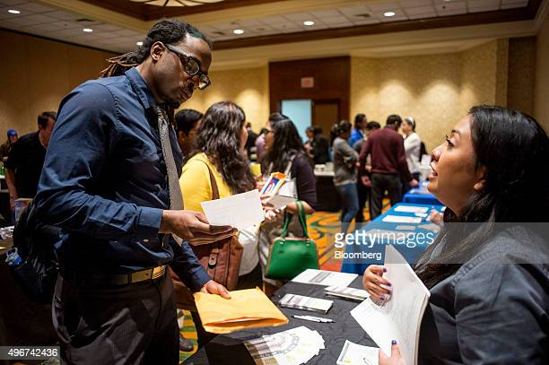 A job seeker left speaks with a recruiter during the San Jose Career Fair in San Jose California US on Tuesday Nov 10 2015 The US Department of Labor...