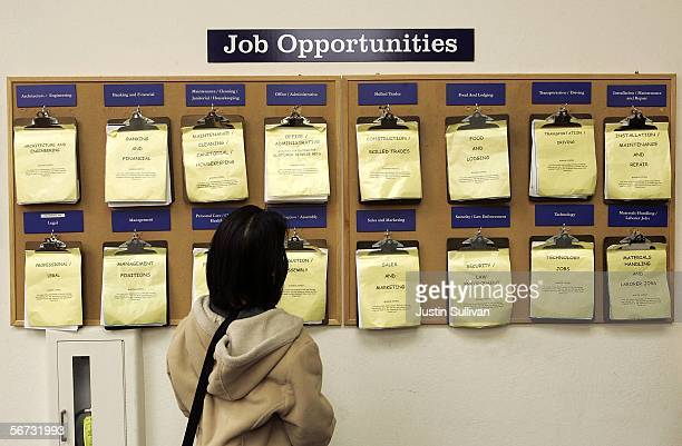 A job seeker looks at a job listing board at the East Bay Career Center February 2 2006 in Oakland California According to a government report US...