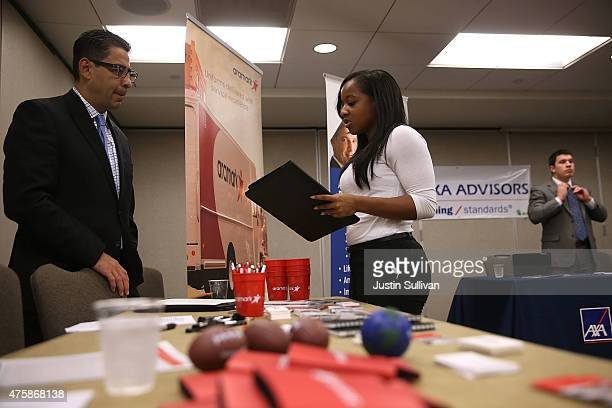 A job seeker meets with a recruiter during a HireLive career fair on June 4 2015 in San Francisco California According to a report by payroll...