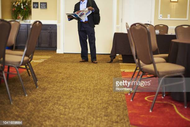 A job seeker reads an employment newsletter during a National Career Fair event in Edison New Jersey US on Thursday Sept 20 2018 Filings for US...
