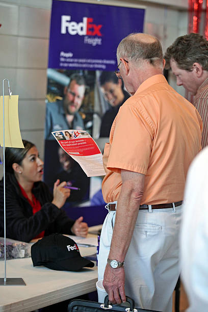 a job seeker reads fedex corp employment information at a hire a vet