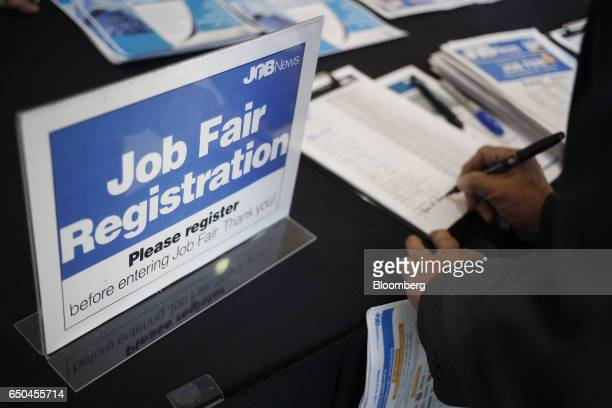 A job seeker registers during a Job News USA career fair in Overland Park Kansas US on Wednesday March 8 2017 Applications for US jobless benefits...