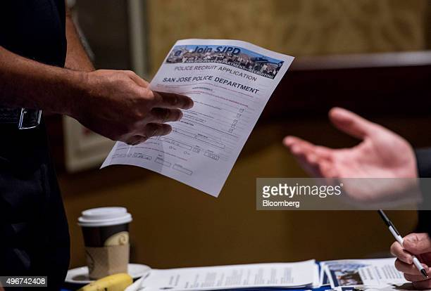 A job seeker reviews an employment application at the San Jose Career Fair in San Jose California US on Tuesday Nov 10 2015 The US Department of...