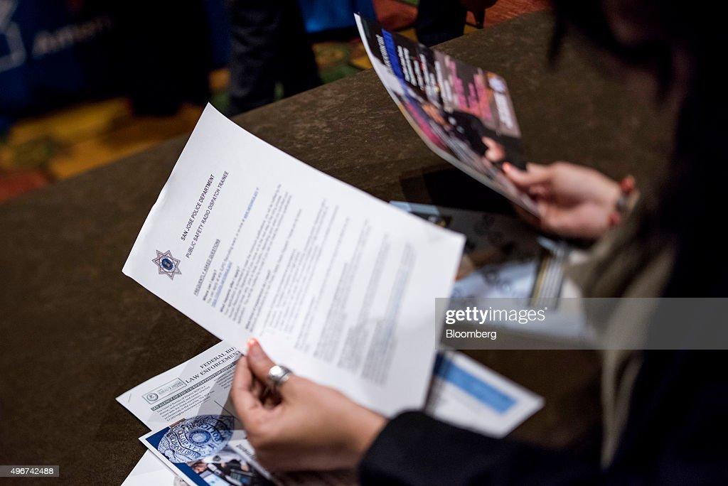 A job seeker reviews paperwork at the San Jose Career Fair