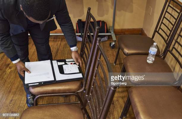 A job seeker reviews paperwork during a Shades of Commerce Career Fair in the Brooklyn borough of New York US on Saturday Feb 17 2018 The latest...
