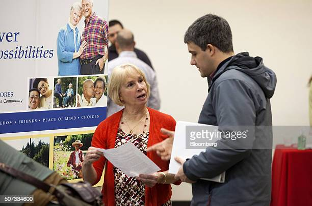 A job seeker right speaks with a company representative during a Choice Career Fair event in Seattle Washington US on Thursday Jan 28 2016...