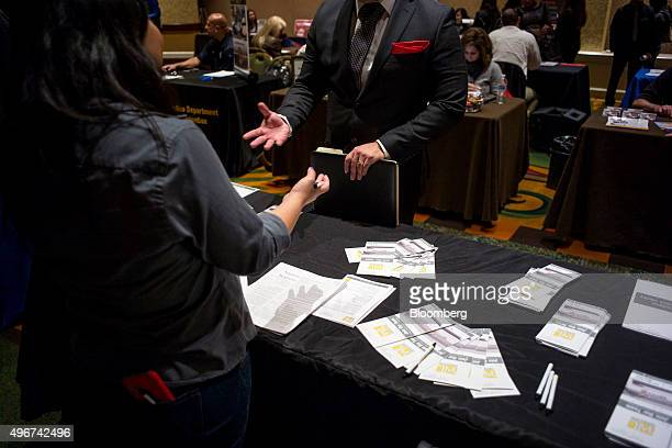 A job seeker right speaks with a job recruiter at the San Jose Career Fair in San Jose California US on Tuesday Nov 10 2015 The US Department of...