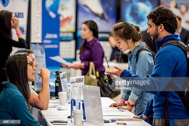 A job seeker right speaks with a recruiter during a career fair at San Francisco State University in San Francisco California US on Friday April 3...
