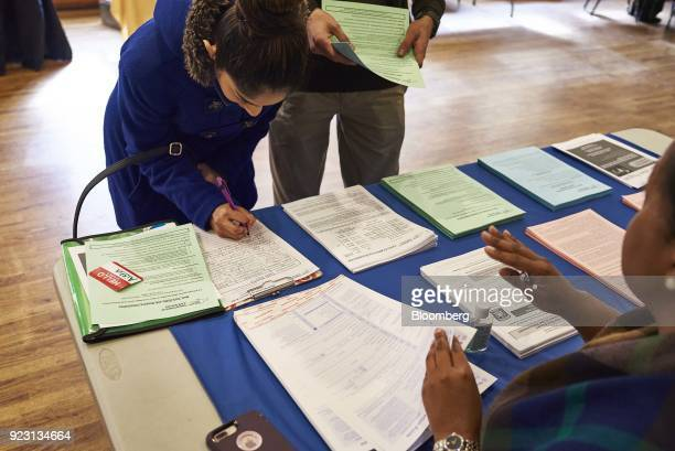 A job seeker signs in during a Shades of Commerce Career Fair in the Brooklyn borough of New York US on Saturday Feb 17 2018 The latest initial...
