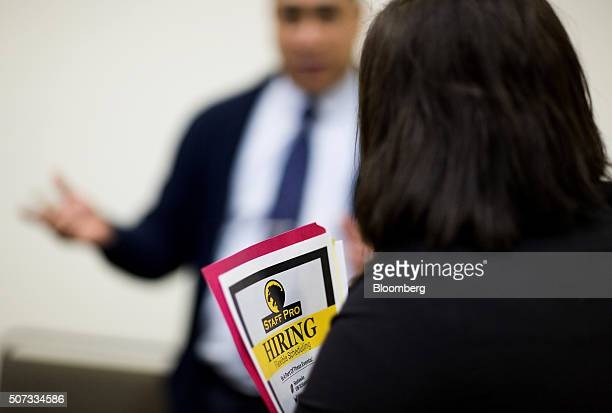 A job seeker speaks with a company representative during a Choice Career Fair event in Seattle Washington US on Thursday Jan 28 2016 Applications for...