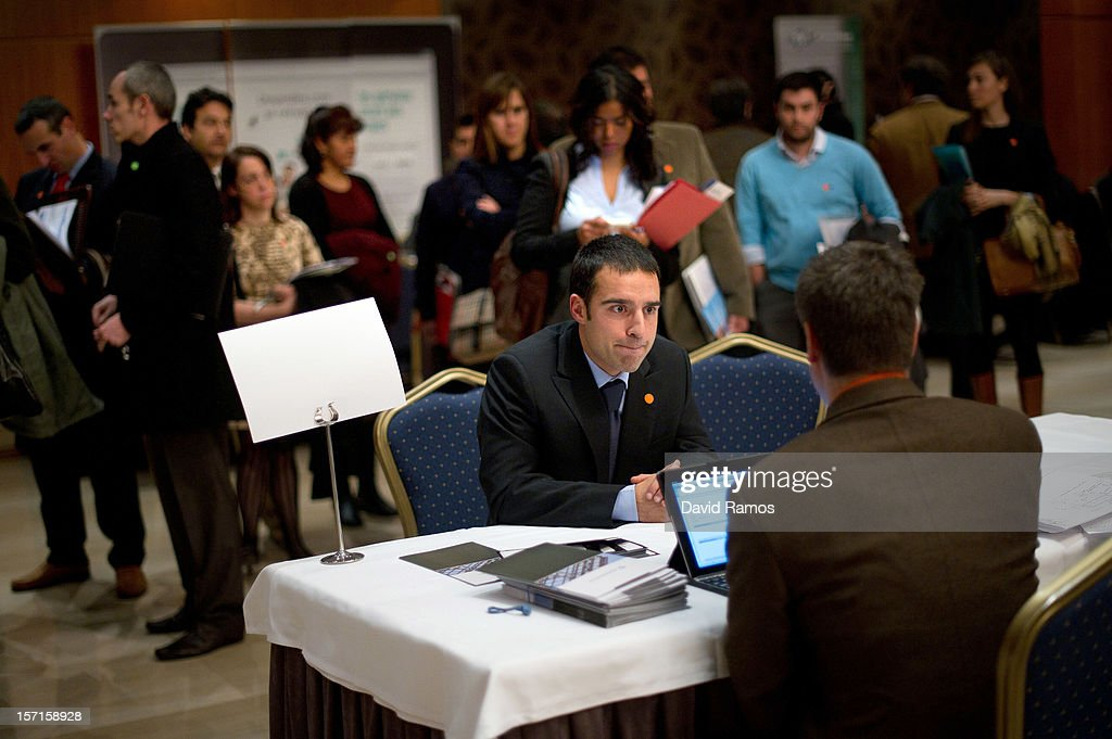 A job seeker (L) speaks with job recruiters during a Job fair organized by the ImmigrationOffice of Quebec in Paris and the Catalonia Employment Service (SOC) on November 29, 2012 in Barcelona, Spain. Over 40 companies from Quebec are offering more than 1000 jobs at two career fairs being held in Barcelona and Paris. Approximately 1300 job seekers attended today's fair in Barcelona after the unemployment rate in Spain increased to 25.02 percent in the third quarter of 2012, the highest in the EU.