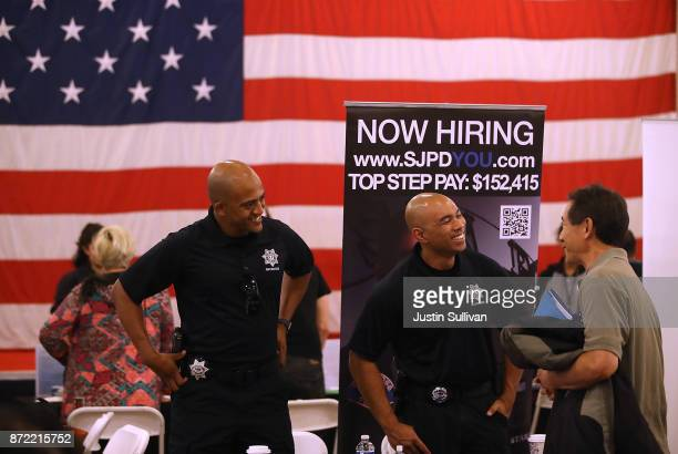A job seeker talks with recruiters from the San Jose police