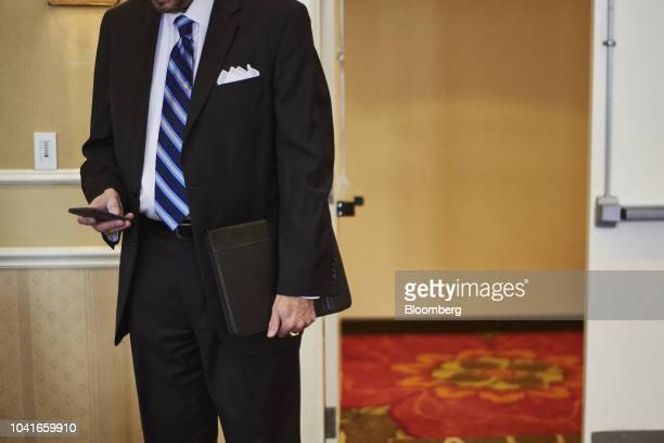 A job seeker views a mobile device during a National Career Fair event in Edison New Jersey US on Thursday Sept 20 2018 Filings for US unemployment...