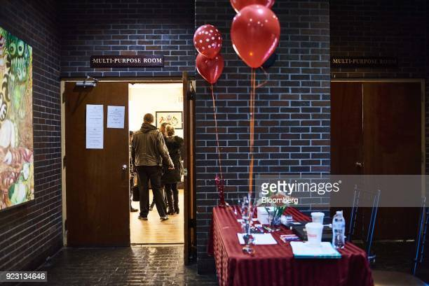 Job seekers arrive for a Shades of Commerce Career Fair in the Brooklyn borough of New York US on Saturday Feb 17 2018 The latest initial jobless...
