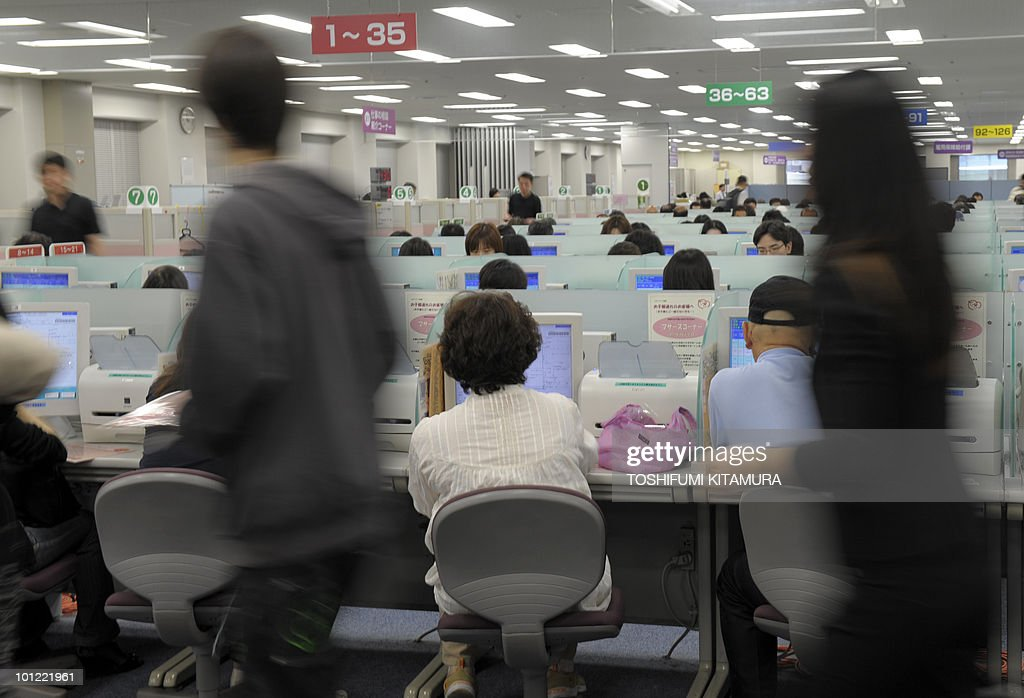 Job seekers check offers on the computer terminals at the employment exchange office in Tokyo on May 28, 2010. Japan's unemployment rate rose to 5.1 percent in April, rising by 0.1 point from the previous month, government data showed.