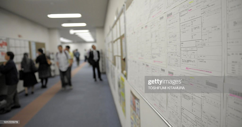 Job seekers check offers on the wall at the employment exchange office in Tokyo on May 28, 2010. Japan's unemployment rose unexpectedly and consumer prices continued to slide, data showed Friday, as deflation and weak domestic demand continue to drag on a gradual recovery from deep recession.