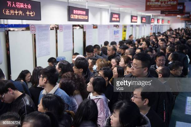 Job seekers crowd to a job fair on February 23 2018 in Taiyuan Shanxi Province of China Companies showcase their job offerings for job seekers in the...