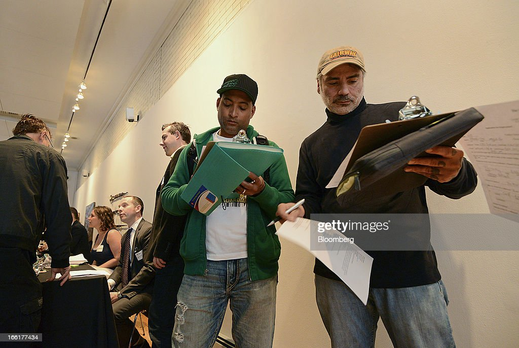 Job seekers fill out applications during the NYC Restaurant Job Expo at the Gabarron Foundation in New York, U.S., on Tuesday, April 9, 2013. The U.S. Department of Labor is scheduled to release jobless claims figures on April 11. Photographer: Peter Foley/Bloomberg via Getty Images