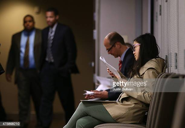 Job seekers fill out registration forms before entering a HireLive career fair on June 4 2015 in San Francisco California According to a report by...
