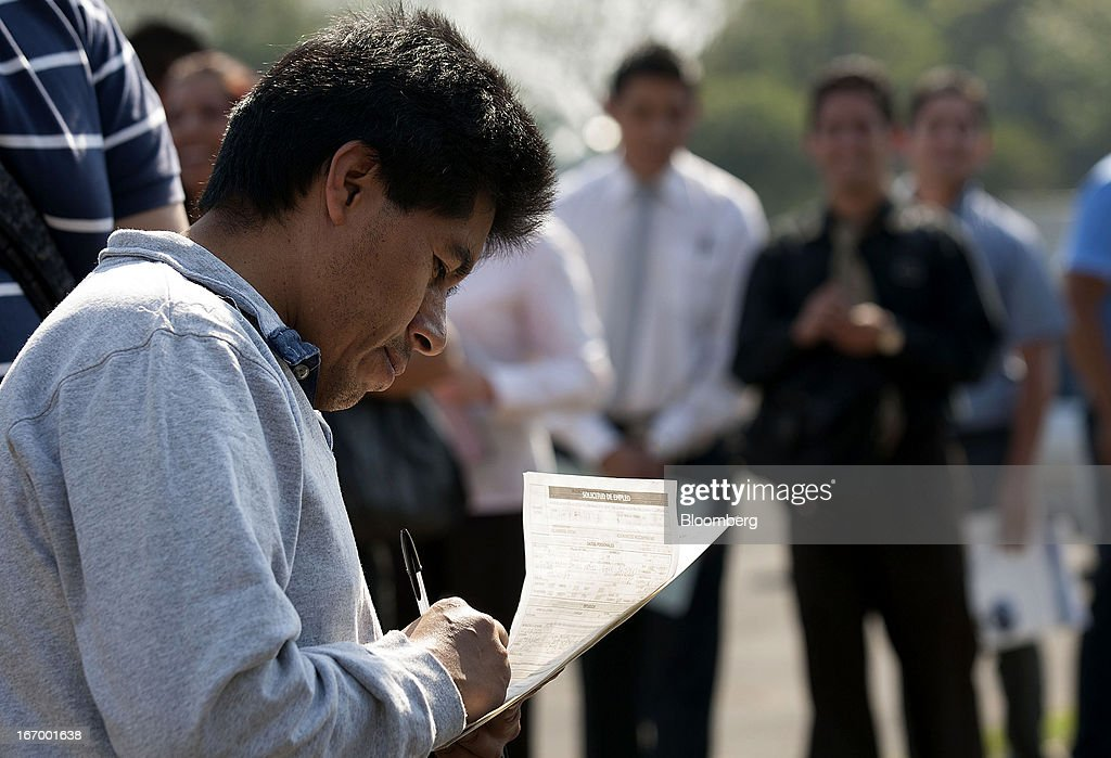 A job seekers fills out an application before entering the XXVII job fair at the Palacio de los Deportes in Mexico City, Mexico, on Thursday, April 18, 2013. Mexico created 53,994 permanent and temporary urban jobs in March, according to reports from the Mexican Social Security Institute (IMSS). Photographer: Susana Gonzalez/Bloomberg via Getty Images