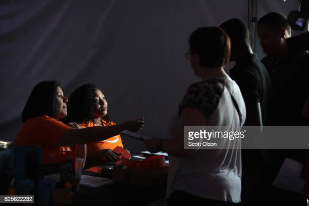 Job seekers hoping to land 1 of the 2500 available jobs check in at the Amazon fulfillment center on August 2 2017 in Romeoville Illinois Amazon is...