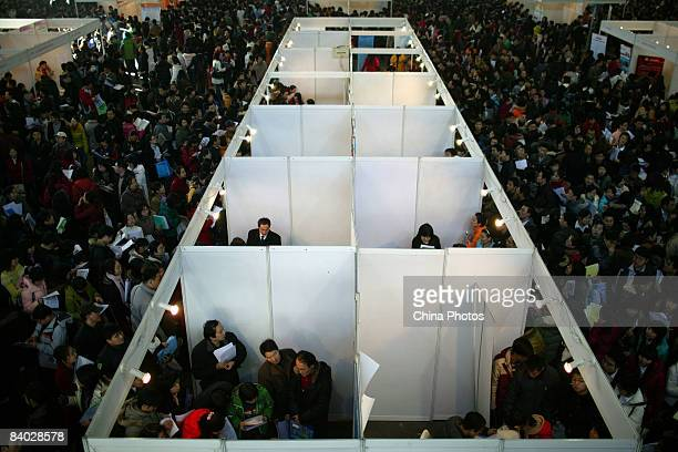 Job seekers join the crowd at a job fair for postgraduate students on December 14 2008 in Beijing China Nearly 40000 applicants competed for...