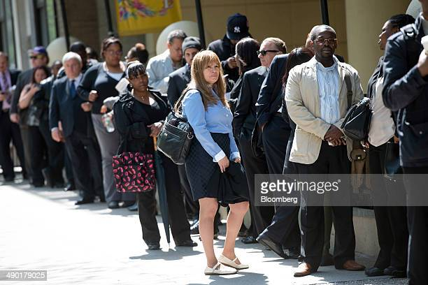 Job seekers line up outside at Choice Career Fairs' New York career fair at the Holiday Inn Midtown in New York US on Tuesday May 13 2014 The US...