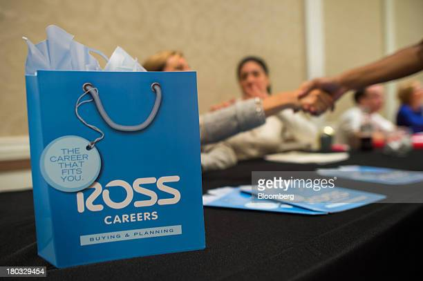 Job seekers meet recruiters for Ross Stores Inc. During an employment fair hosted by Premium Job Fairs in New York, U.S., on Tuesday, Sept. 10, 2013....