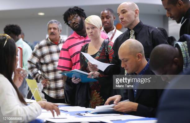 Job seekers meet with recruiters at a job fair hosted by the Los Angeles Mission on March 05 2020 in Los Angeles California The annual event located...