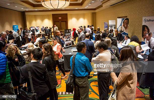 Job seekers meet with recruiters during the San Jose Career Fair in San Jose California US on Tuesday Nov 10 2015 The US Department of Labor is...