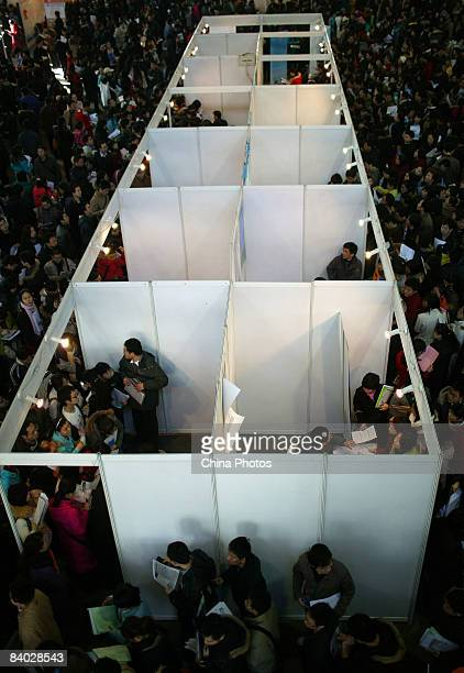 Job seekers pack a job fair for postgraduate students on December 14 2008 in Beijing China Nearly 40000 applicants competed for approximately 14228...