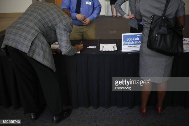Job seekers register during a Job News USA career fair in Overland Park Kansas US on Wednesday March 8 2017 Applications for US jobless benefits...
