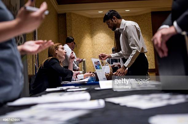 Job seekers right speak with recruiters at the San Jose Career Fair in San Jose California US on Tuesday Nov 10 2015 The US Department of Labor is...