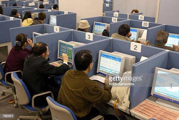 Job seekers search for employment on computer terminals at the Hellowork employment agency March 29 2002 in Tokyo Japan Japan's unemployment rate...