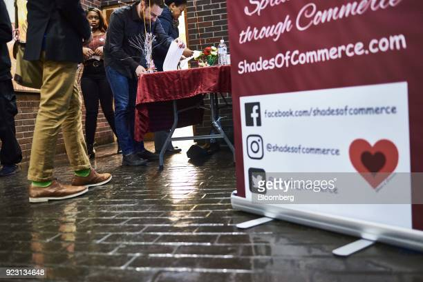 Job seekers sign in during a Shades of Commerce Career Fair in the Brooklyn borough of New York US on Saturday Feb 17 2018 The latest initial jobless...