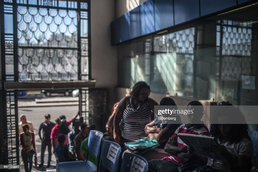Job seekers sit in a waiting area at the Ministry of Labor and Employment building in Rio de Janeiro, Brazil, on Monday, June 19, 2017. The Brazil Labor Ministry is scheduled to release government registered job creation figures on June 20. Photographer: Dado Galdieri/Bloomberg via Getty Images