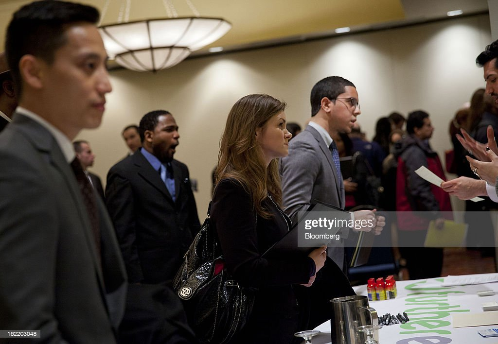 Job seekers speak to recruiters at a job fair organized by United Career Fairs in New York, U.S., on Tuesday, Feb. 19, 2013. The U.S. Labor Department is scheduled to release initial jobless claims figures on Feb. 21. Photographer: Jin Lee/Bloomberg via Getty Images
