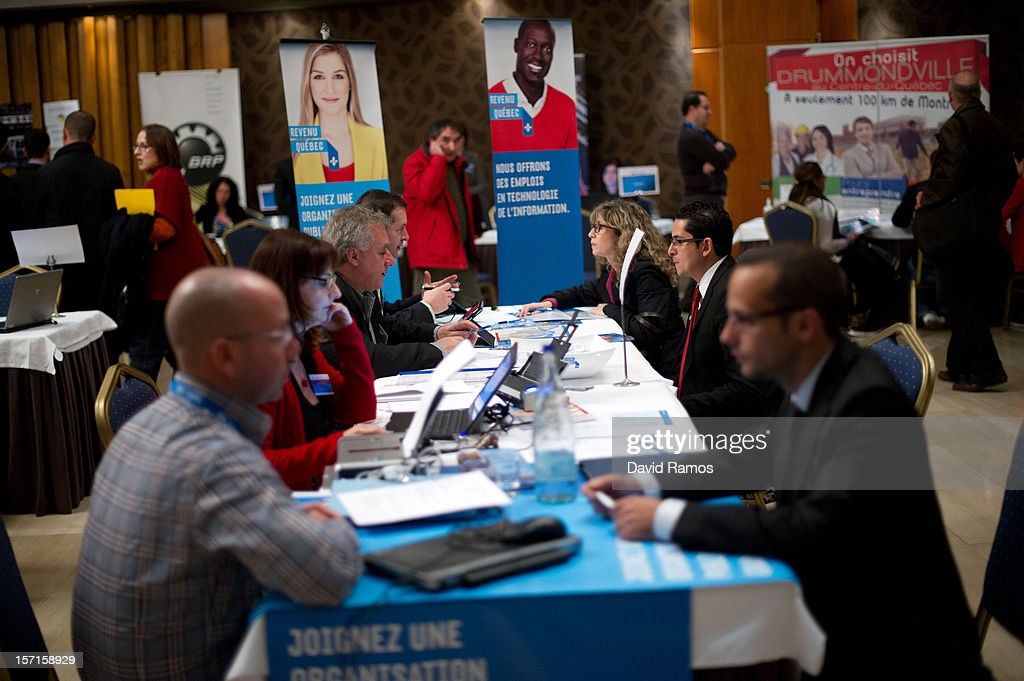 Job seekers (R) speak with job recruiters during a Job fair organized by the ImmigrationOffice of Quebec in Paris and the Catalonia Employment Service (SOC) on November 29, 2012 in Barcelona, Spain. Over 40 companies from Quebec are offering more than 1000 jobs at two career fairs being held in Barcelona and Paris. Approximately 1300 job seekers attended today's fair in Barcelona after the unemployment rate in Spain increased to 25.02 percent in the third quarter of 2012, the highest in the EU.