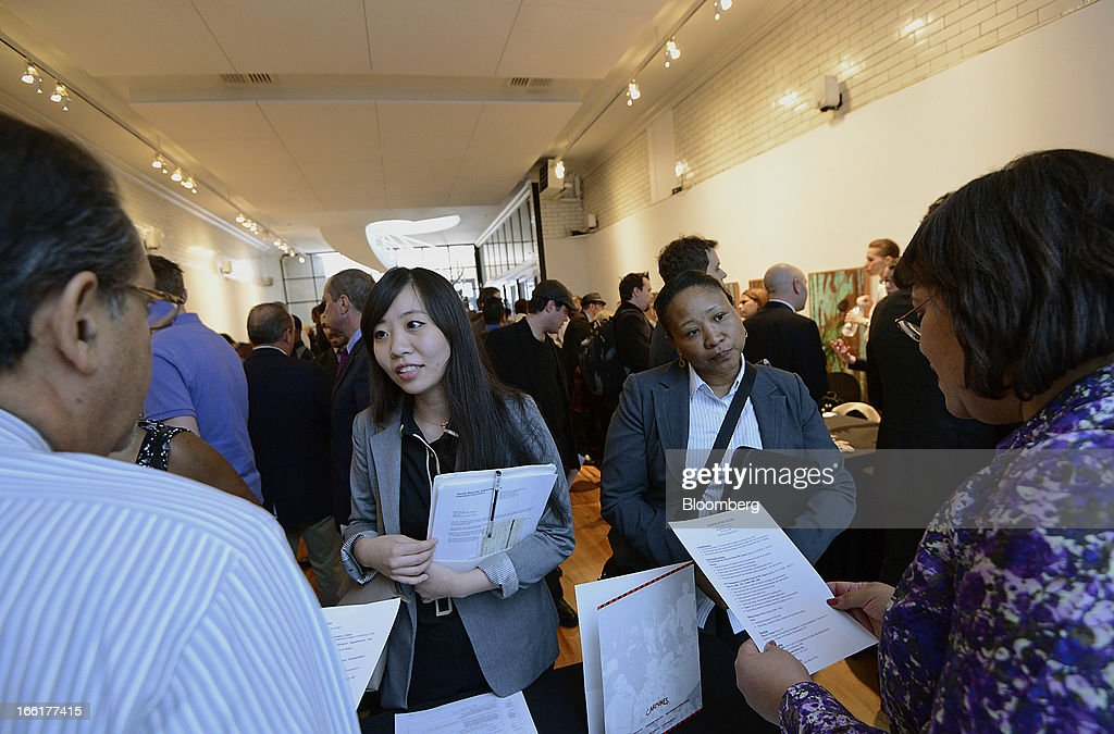Job seekers speak with recruiters during the NYC Restaurant Job Expo at the Gabarron Foundation in New York, U.S., on Tuesday, April 9, 2013. The U.S. Department of Labor is scheduled to release jobless claims figures on April 11. Photographer: Peter Foley/Bloomberg via Getty Images